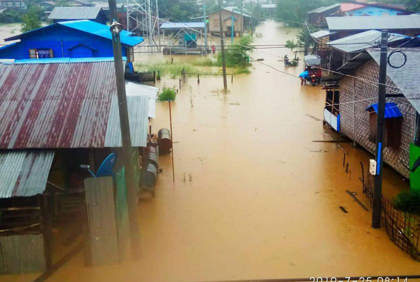 Flood water covered a residential area in Mogaung